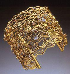 Bracelet, 14k, 18k, uncut and cut diamonds, iolites, garnets by Todd Reed, Mobilia Gallery