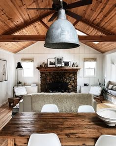 Modern rustic kitchen with wooden classing and beamed ceiling and cosy fireplace with logs pilled up to create a warm rustic space. Would love to dine around this huge vintage farmhouse kitchen with the vintage industrial lighting Cabin Design, House Design, Modern Cabin Interior, Cozy Cabin, Cozy Cottage, Cabin Homes, White Walls, White Wood, Home And Living