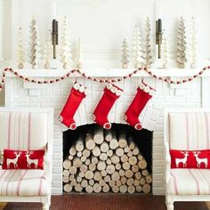 Red & white swedish scandanavian shabby chic winter christmas fireplace logs mantle display with stockings and garland