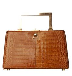 Vintage 1950s crocodile purse with copper handle - $120.