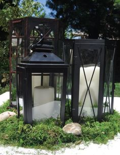 DIY Lantern Centerpieces - wedding candles centerpieces lanterns moss maybe would add small lights around it Lantern Centerpiece Wedding, Candle Wedding Centerpieces, Wedding Lanterns, Centerpiece Decorations, Candle Lanterns, Diy Lantern, Wedding Decorations, Candles, Lantern Lighting