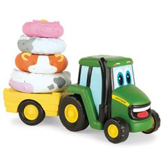 Features Johnny Tractor and pulling wagon with four removable animal rings. Animal sounds activated when stacked correctly. When tractor is pushed, the stack will spin. Press cab roof to easily play m