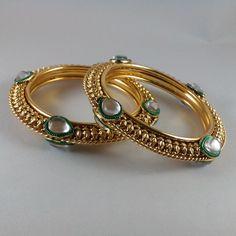 Buy designer gold tone bangle set with white enamel at haveaclick