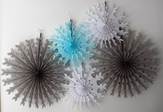 Made in USA tissue paper snowflakes - gray, white, and light blue. Devra Party on Amazon.