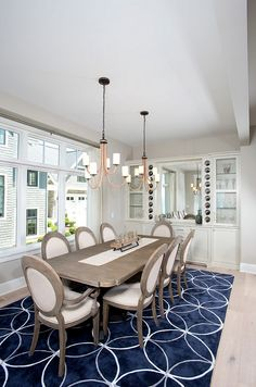 Storybook Shingle Beach House. This dining room also features extensive built-ins with extra storage and workspace, such as that distinctive dining serving piece featuring quartz stone and a lake reflecting mirror, which certainly maximizes space and make entertaining a breeze.