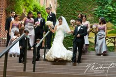 The grand staircase and ivy wall are perfect backdrops for wedding photos.