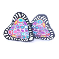 Zentangle heart pins by Jennifer D Burrell.  Click image to purchase this brooch with FREE Shipping!   These heart pins were made out of polymer clay.  Canes of different colored clay were stacked and sliced to reveal beautiful patterns.  Pin to your Polymer Clay and Handmade Jewelry boards.