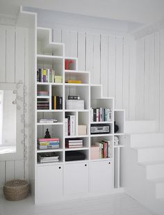 Looking to up your storage game? Look no further because these shelves were made for small spaces! These shelving ideas will lighten and brighten up your space. For more tips on small spaces and big storage, head to Domino. Space Saving Staircase, Space Under Stairs, Staircase Storage, Stair Storage, Staircase Design, Staircase Ideas, Open Staircase, Small Space Staircase, Stair Design