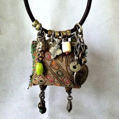 Gypsy amulet necklace with Hmong textile kuchi leather by quisnam, $60.00