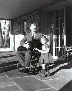 Franklin D. Roosevelt with Fala and Ruthie Bie in Hyde Park, New York, 1941 One of the few photographs of Roosevelt in his wheelchair. (from: http://ourpresidents.tumblr.com)