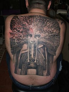 What IS this tattoo?!? Whatever it is ... it's creepy