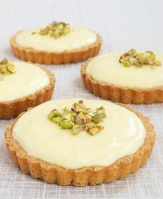 Lemon Cream Tarts feature a sweet, tart, creamy lemon filling inside a sugar cookie crust. Delicious! - Bake or Break
