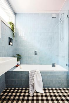Light blue subway tiles create a fresh coastal feel in this family bathroom. A dated red brick bungalow in Sydney's Northern Beaches has been given a fresh new look with a painted brick exterior and modern interior renovation on a budget. Shower Bath Combo, Shower Over Bath, Bath Shower Combination, Bathroom Red, Family Bathroom, Bungalow Bathroom, Light Blue Bathrooms, Red Bathrooms, Modern Bathrooms