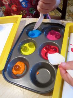 Crafts for 3 Year Olds | They first rolled the marbles around in the paint with a spoon.