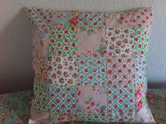 Patchwork cushion with cath kidston fabrics by patchwork and lace, via Flickr