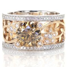 Design 2846 - This custom two tone engagement ring is a real statement piece. The hints of yellow in the champagne colored center diamond ar...