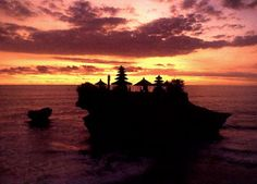 Pura Tanah Lot, a temple built on a very small island in Indonedia. Supposed to grant divine security from the sea.