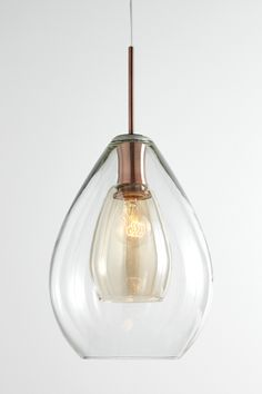 Carmella Pendant - £80  Add a futuristic touch to your interiors with the double walled glass Carmella pendant light with its trendy copper accents