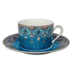Dhara Tea Cup in Peacock Blue from Williams&Sonoma. Middle Eastern, Persian, Moroccan design.  Inspired by magnificent Persian motifs, Deshoulières' ornate Dhara pattern reinterprets delicate filigrees found in a 17th-century poetry manuscript. Each piece bears a unique variation on the design, composed of twelve colors from black to peacock blue and embellished with platinum accents. Artisans handcraft the collection from premium Limoges porcelain at the workshops of Deshoulières, makers of…