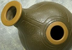 The Udu drums are very similar to the East Indian Ghattam drums. They come in many shapes and sizes. By opening and covering the holes, while hitting the sides, the player creates a variety of sounds.