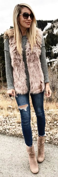 #winter #outfits grey sweater, faux fur sleeveless coat, ripped jeans, beige boots