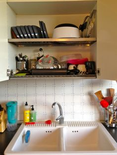 Love the Finnish, Italian & German domestic engineering installment of dish drainer above sink. It's lovely, pragmatic, frees up counter space, no pressure to put away. It's a win-win!