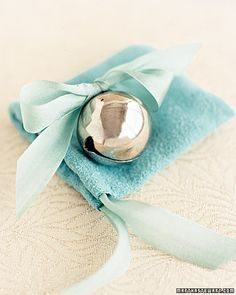 Each guest receives a silver bell tied with ribbon and tucked in a suede bag to ring during the recessional.