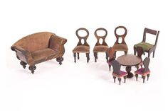 Waltershausen dolls' house furniture: comprising a sofa with grained finish and faded purple velv