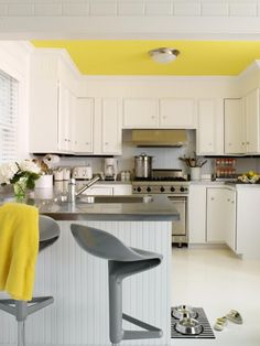 Suzie: Tara Seawright - Modern yellow & gray kitchen with bright yellow painted ceiling, gray ...