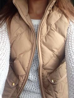 Love the layer of the neutral vest over the white airy sweater.  So natural but stylish.