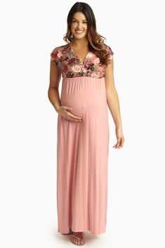 Just a subtle feminine touch with its floral draped top, this maxi dress quickly becomes one of our favorite maxis this season. Mocha-Floral-Pink-Draped-Top-Maternity/Nursing-Maxi-Dress