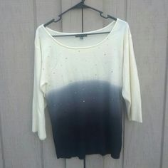 Soft Cream to Navy Top Has little gems on the front and is so soft and pretty. Woman's small and is 100% acrylic. Made in China. Notations Sweaters