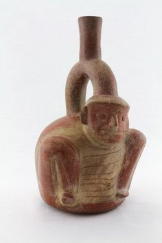 Photograph; Vessel Circa. 1200 to 200 B.C.E. Cultural group; Chavin Country; Peru Materials; Ceramic, and pigment Measurement; h. 27.00 cm. Gifted; Dr. and Mrs. Robert Kuhn Museum Purchase; X73.223 COPYRIGHT © Fowler Museum