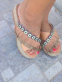 A personal favourite from my Etsy shop https://www.etsy.com/listing/450050656/evil-eye-fringe-greek-sandals