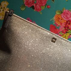 """NWT 2xHP!Kate spade silver glitter bug clutch Brand new with tag. Never used. Glittery smooth exterior. Nylon interior printed with """"kate spade."""" Works as a clutch or cosmetic bag. 7.5""""x10.25"""". If you bundle items in my closet you get a lovely discount  kate spade Bags Clutches & Wristlets"""