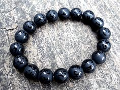This unique bracelet was made of high quality carved black agate Om Mani Padme Hum. It comes in 8mm and 10mm. It brings protection, good fortune, harmony and balance.