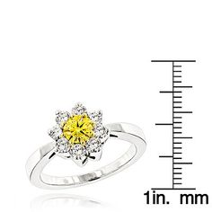 Beautiful White and Yellow Diamond Cluster Rings for Women: This 14K Diamond Daisy Ring showcases 1.2 carats of top quality sparkling round diamonds set in a cluster/flower design. Featuring a lovely yellow diamond in the center and a highly polished gold finish, this ladies diamond ring makes a fabulous pre-set diamond engagement ring or a 7 year anniversary gift, and is available in 14K white, yellow and rose gold.
