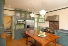 Queen Anne Renovations, Caruso House, Dorchester. Love the view, love the colors, love the cabinets that go all the way to the floor (no toe-kick), except at the sink/prep areas, love the lights, and the door and the natural light. ~happy sigh~