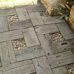 Garden path made with recycled timber and pebbles