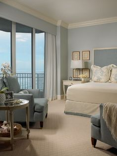 traditional, cozy beach bedroom in tranquil shades of blue withwhite. Intrinsic Designs