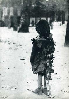 Little girl with fallen leaves. Jardin du Luxembourg (Luxembourg Garden), Paris, 1946