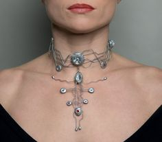 Bionic choker by DominicElvinDesign on Etsy, £40.00.  This is amazingly sci-fi.  I love the model too, check those collarbones!