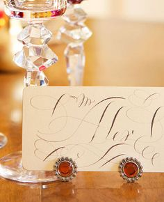 Great Gatherings: Glamorous Dinner Party—With a Purpose - Traditional Home.  Vintage Earrings used as placecard holders.