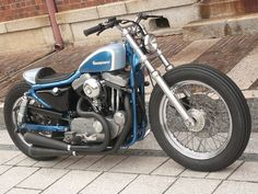 Blue & silver Evo Sportster swingarm custom with cafe-style rear tail section by Gravel Crew