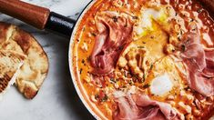 Spicy Chickpeas with Runny Eggs and Prosciutto - Chickpeas in a spicy tomato-cream bath are what you need on a weeknight.