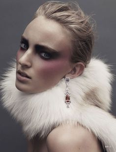 Ymre Stiekema by John Akehurst for Exit. (I love how the earring is displayed against the fur)
