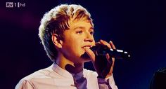 """Niall in that white shirt singing """"Chasing Cars"""" on the XFactor UK 2010 (gif)."""