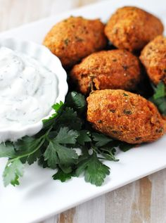 """""""Salmon Ball Croquettes with Herb Sauce""""    by Jennifer at """"Savoring the Thyme""""    Okay, I chose this recipe because I don't really like salmon, but know it is good for me, and that I should eat more.  These look good and Jennifer provides directions for both frying (tastier) and baking (healthier).  So, I just might try these. ~Karen 1.24.2012"""