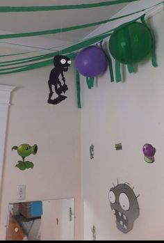 Plants vs Zombies Birthday - Cut zombie and plant shapes out of craft foam for decor. Ceiling hangings were double-sided, one-sided for wall.