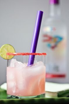 Loopy-Rita: 1½ oz Three Olives Loopy Vodka - 1 oz Triple Sec - 1 oz sweet & sour mix - ½ oz lime juice - ½ teaspoon granadine. Rim a glass with colored sanding sugar mixed with a hint of salt. Fill glass with ice.  Combine ingredients into a cocktail shaker filled half-way with ice. Shake well, strain and pour into prepared glass. Garnish with a slice of lime.